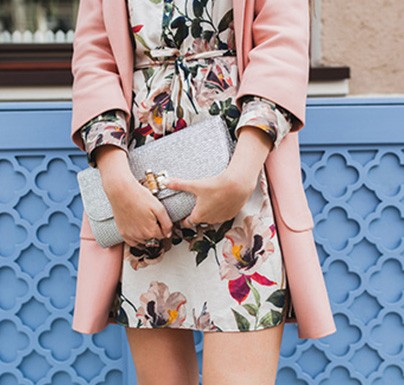 White dress with flower patterns and pink coat