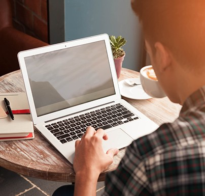 Man sitting in front of the laptop
