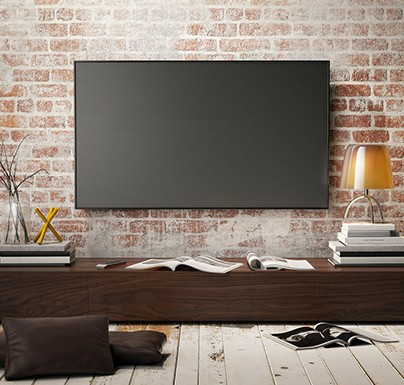 TV screen on a living room wall