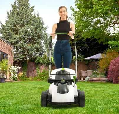 Woman mowing the garden