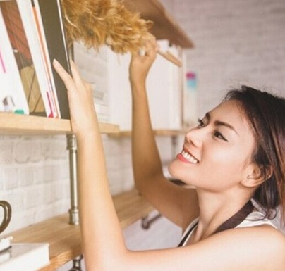 Woman cleaning the shelves